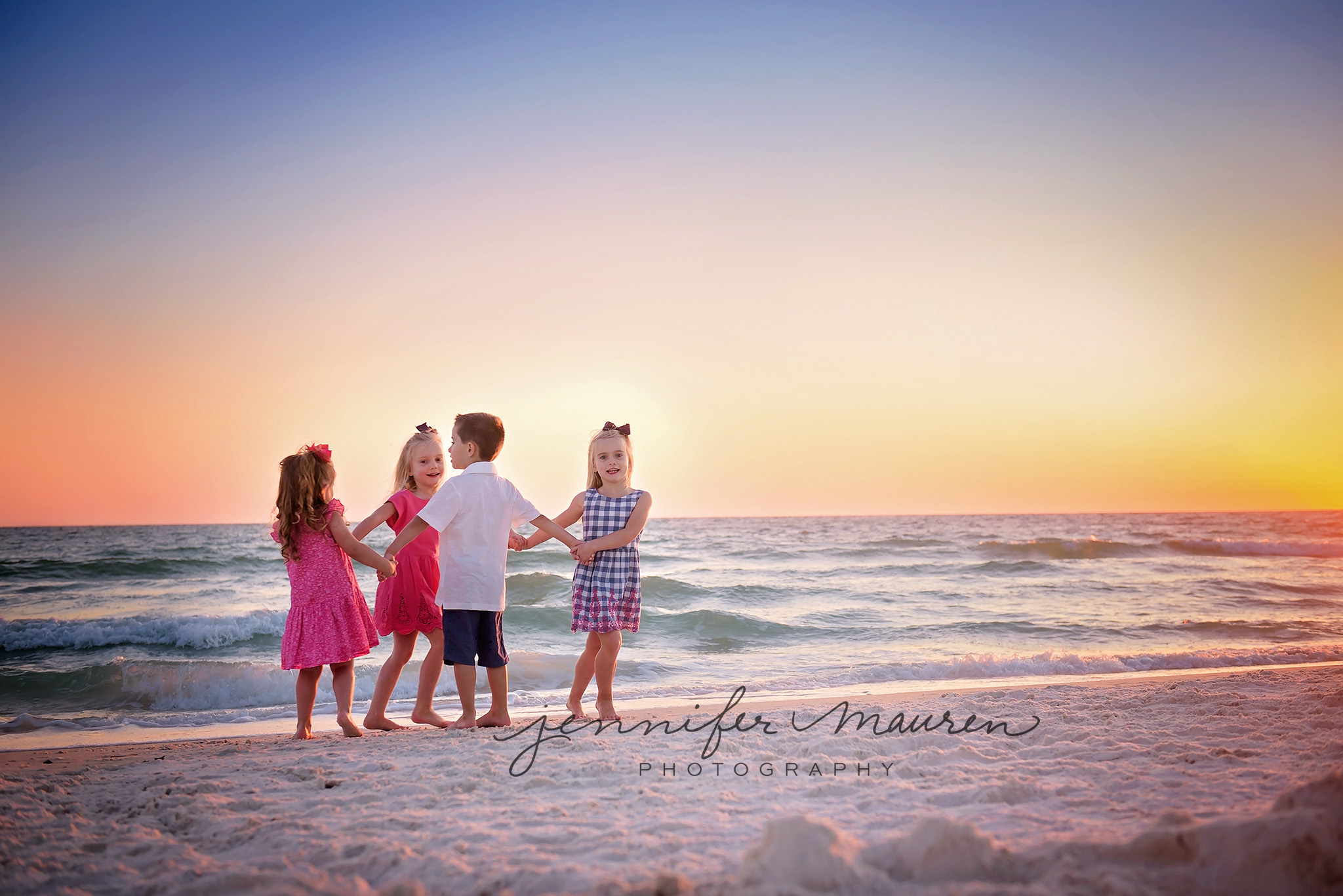Kids playing on beach with sunset