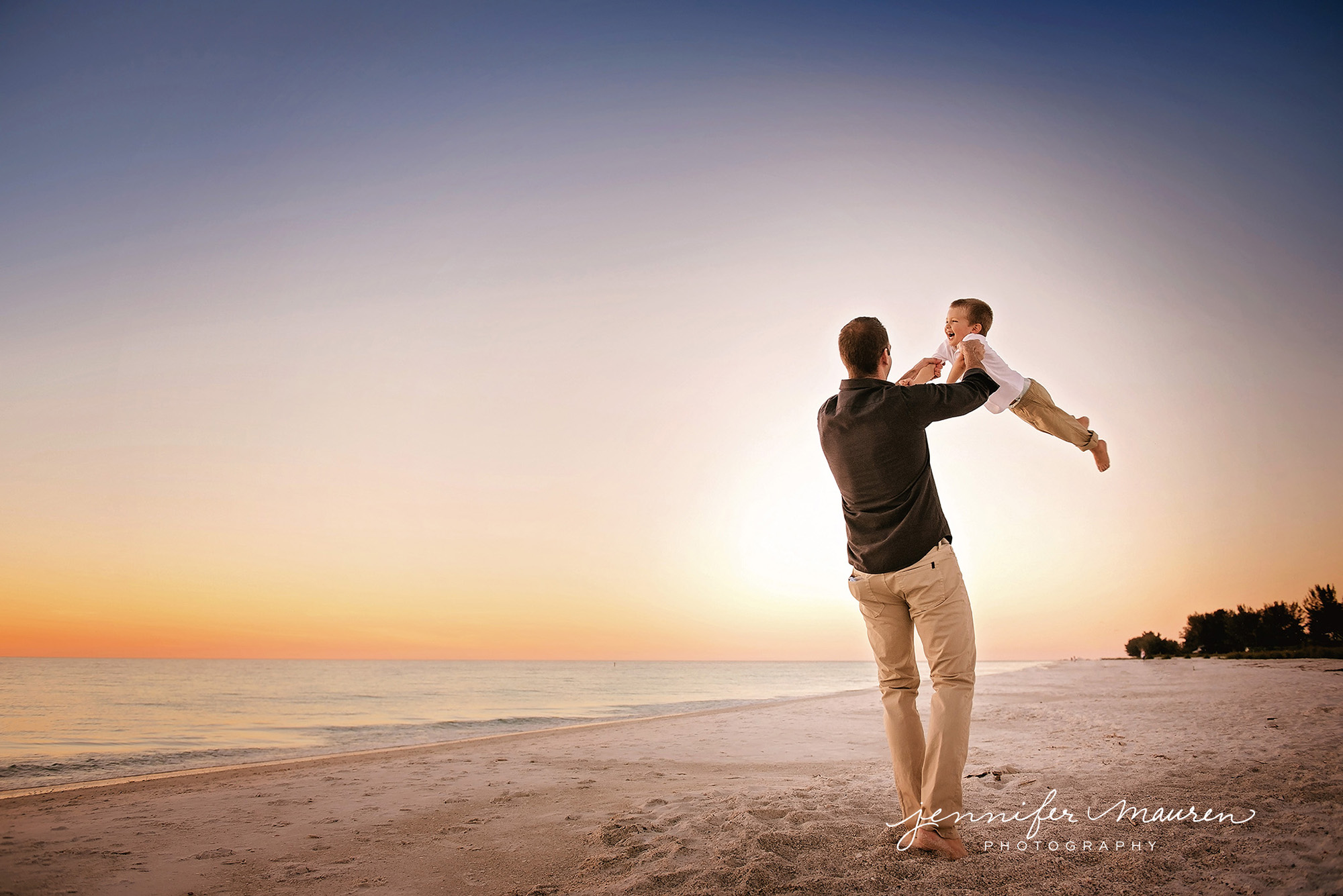 dad and son on the beach