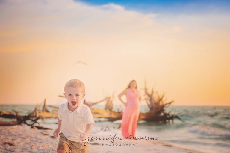 boy running with sand