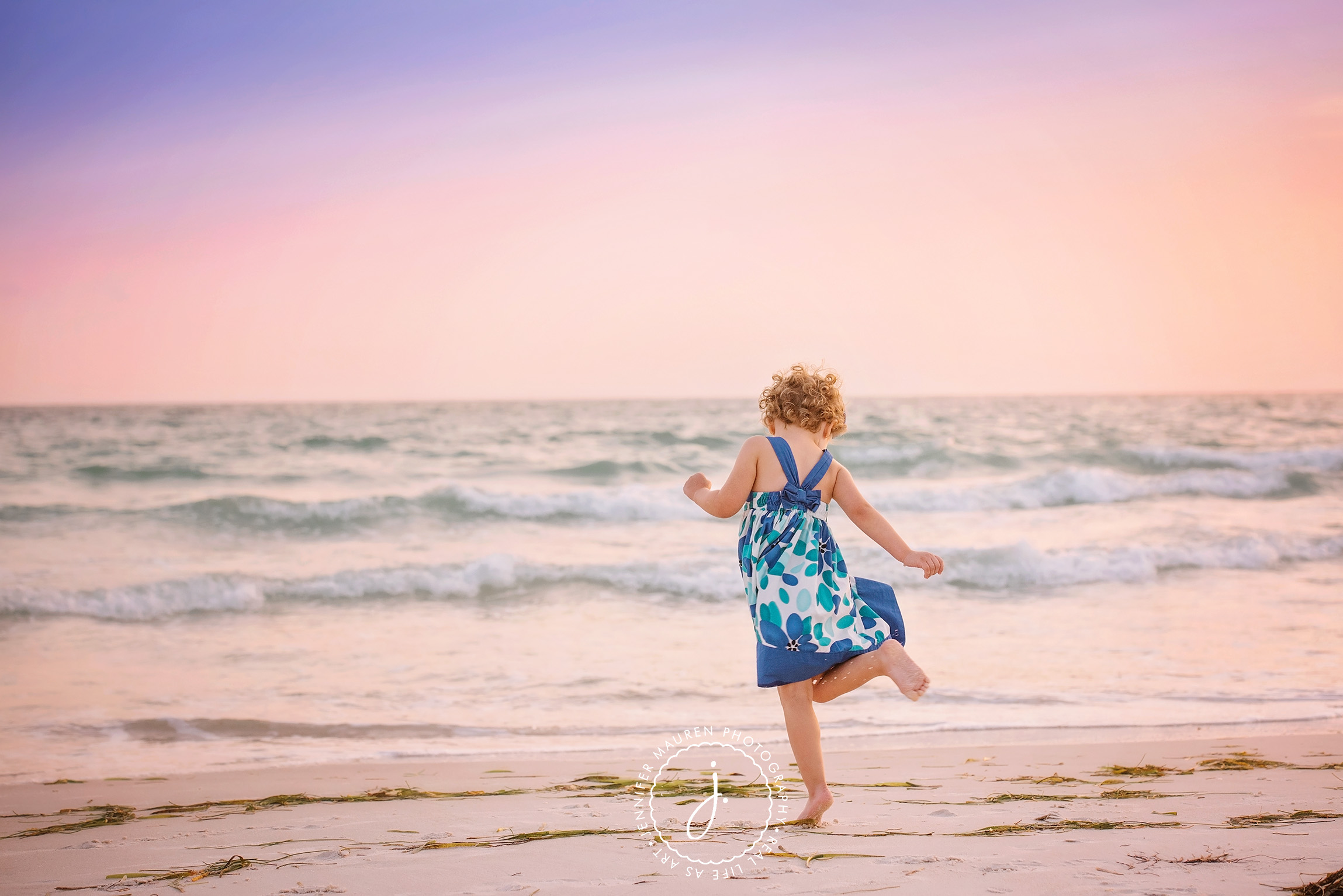 girl skipping on the beach