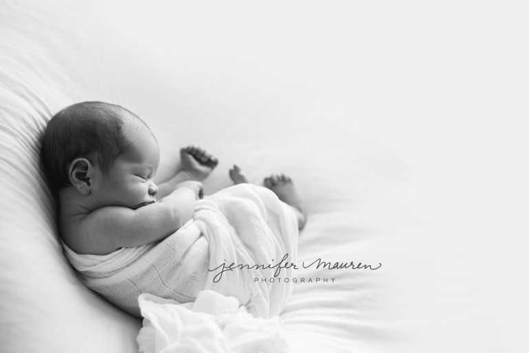 black & white newborn in cloth