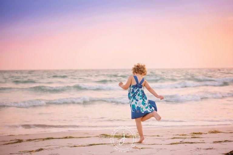 girl dancing on beach