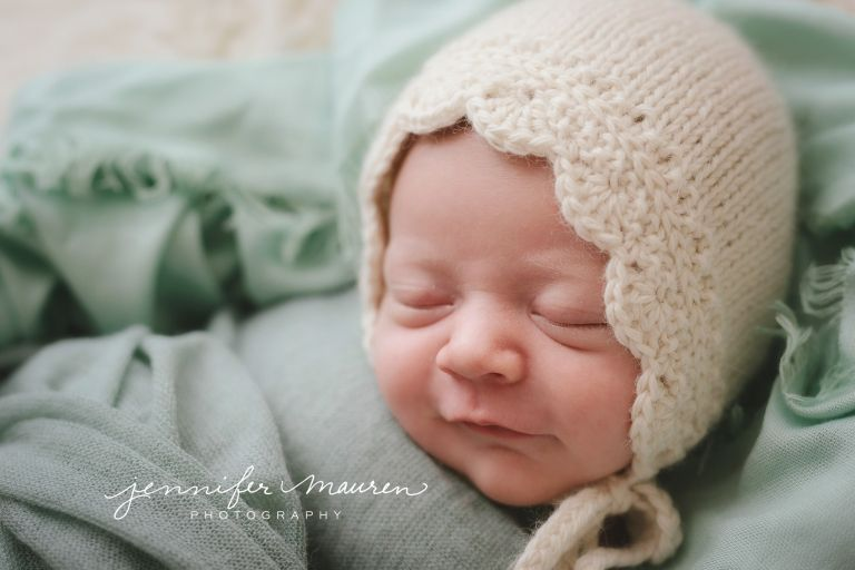 newborn baby girl on aqua and cream