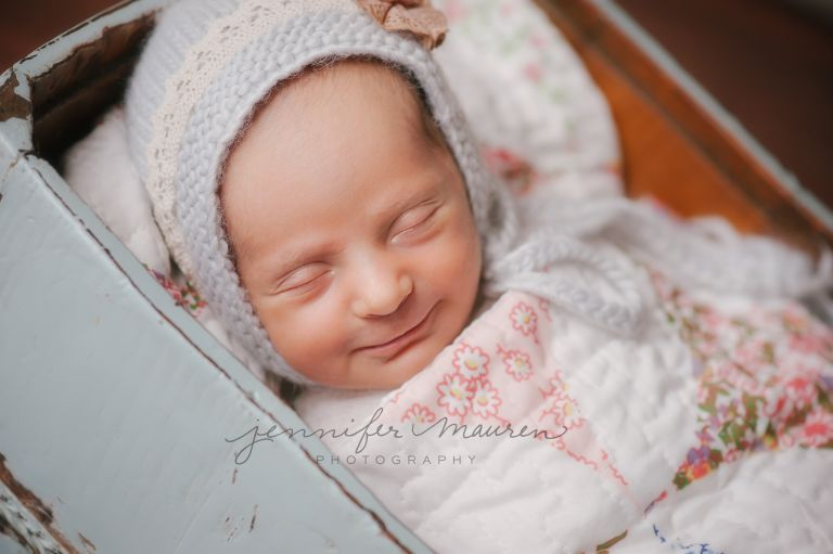 newborn wrapped in a quilt